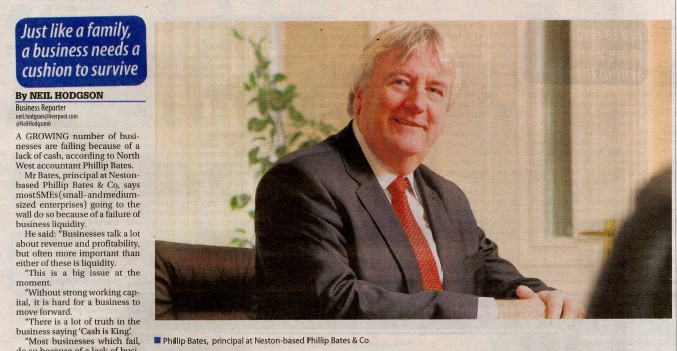 A newspaper clipping saying 'ignore liquidity at your peril, warns accountant'