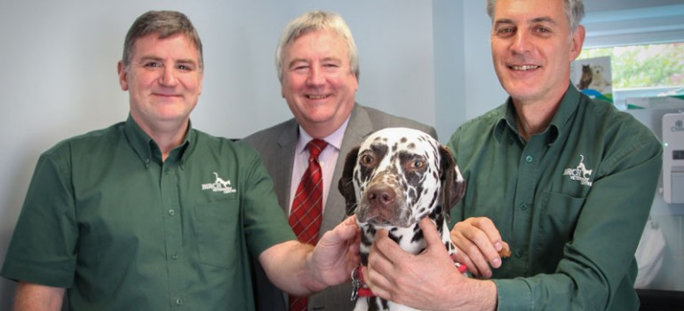 Phillip bates smiling with Vets & a Dalmatian at Birch veterinary centre