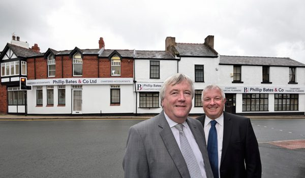 Phil Bates and Alan Mellor stood outside Philip Bates accountants