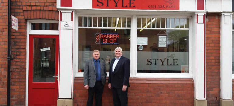L R Tony Collins and Phil Bates Stood outside barber shop